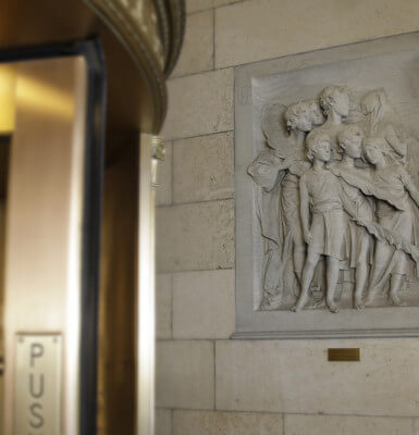 The lobby entrance's limestone friezes were salvaged from the Vanderbilt mansion.