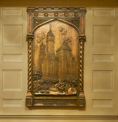 The Sherry's 38-story exterior and elaborate Gothic minaret are captured in this lobby carving.