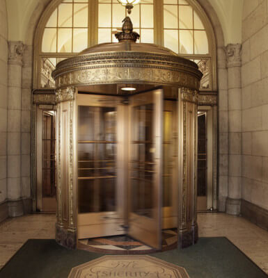A gilded revolving door is a true sign of midtown Manhattan hotel luxury.