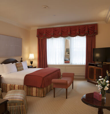 With decor accented in deep reds, Interior Room #915 is a comfortable room for your NYC trip.