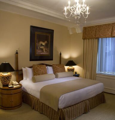 Interior Suite #814 is decorated in warm browns and beiges beneath a lovely chandelier.
