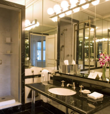 The One-Bedroom Central Park Suite #405 also features a bathroom complete with toiletries.