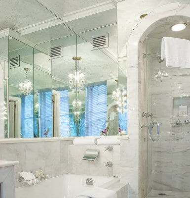 Interior Suite #1014 features a gorgeous marble tub and walk-in shower.