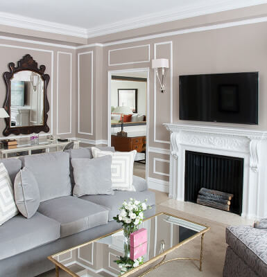 Beautiful moldings and fireplace cast a warm vibe in City View Suite #2309.