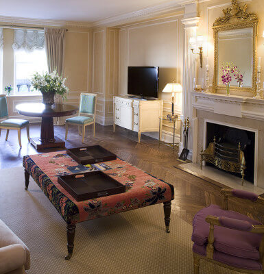 Park View Suite #301 is a two-bedroom suite with views of Central Park and detailed moldings and fireplace.