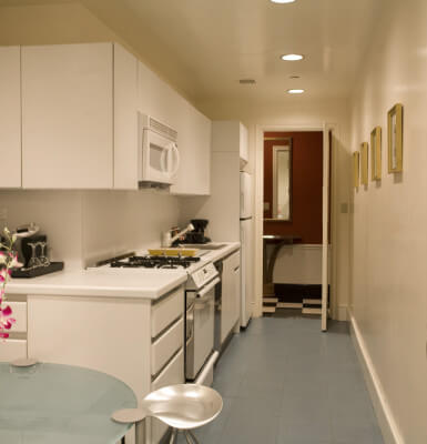 Park View Suite #301 has a full kitchen complete with microwave, stove, and refrigerator.
