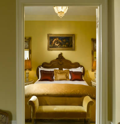 Suite #1909 offers a lovely bed and chandelier.