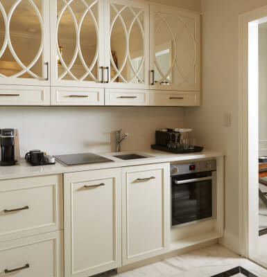 Suite #2111 features a lovely kitchenette with a sink, oven and cooktop.