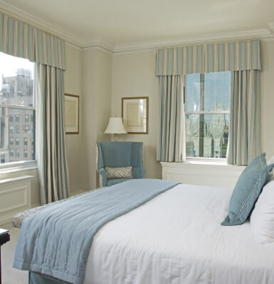 This corner master bedroom in City View Suite #2111 allows multiple views of New York City.
