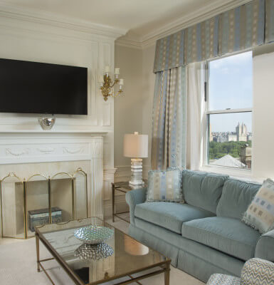 Gaze out the windows from the living room in Suite #2111 at stunning views of Central Park.