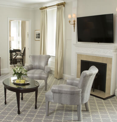 A fireplace with flat screen TV make for a comfortable place to relax in Interior Suite #1114.