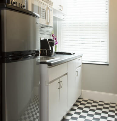 Interior Suite #1114 features a quaint kitchen for guests who want to enjoy a meal in this lovely suite.