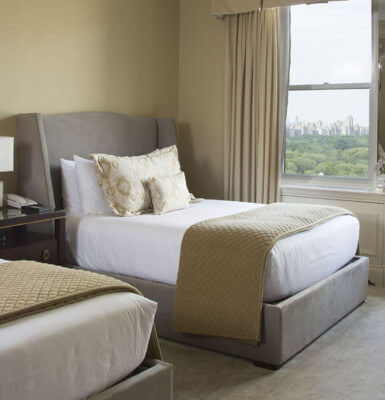 Room #2113 features two double beds with a view of the city.