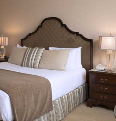 Decorated in warm Earth tones, City View Room #2013 offers a king sized bed.